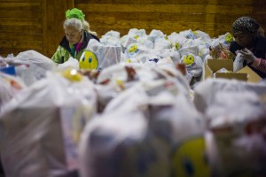 A volunteer at a food pantry in the Bronx. Credit Ángel Franco/The New York Times